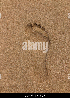 Footprint in soft, golden sand on a beach in Cyprus - Stock Image