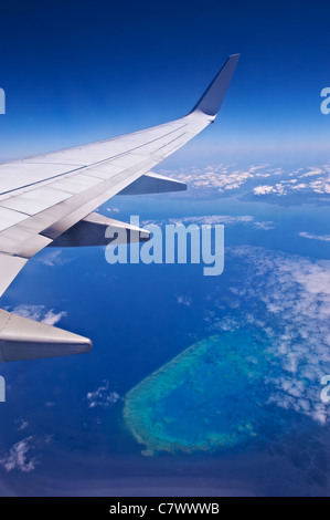 View from airline flying over the Great Barrier Reef Australia - Stock Image