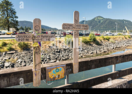 Two crosses form a memorial for two young people who died on the Sing Lee Alley bridge across Hammer Slough in Petersburg, Mitkof Island, Alaska. Petersburg settled by Norwegian immigrant Peter Buschmann is known as Little Norway due to the high percentage of people of Scandinavian origin. - Stock Image