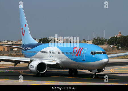 TUI Airways Boeing 737-800 passenger jet plane taxiing on arrival in Malta. Air travel and tourism. - Stock Image