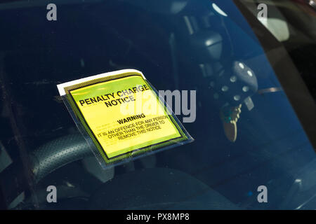 A fixed penalty charge notice on the windscreen of a car in the UK - Stock Image