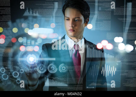 businessman looking at futuristic interface screen. - Stock Image