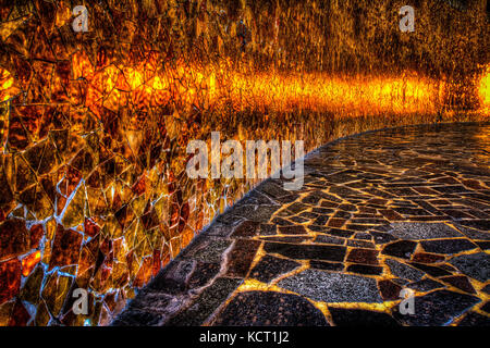 Paving slabs by mosaic close-up. Road paving, construction . Fixed tessellated sidewalk tile. Colored concrete paving - Stock Image