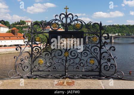 The Lorraine Cross on Charles Bridge, Prague.The brass cross is where Saint John of Nepomuk's body was thrown - Stock Image