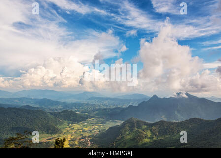 Beautiful landscape blue sky with white cloud above high mountain of the Phi Pan Nam Range from view point on Phu - Stock Image