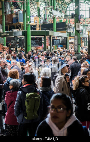 Crowds of tourists in a busy Brough Market in London. - Stock Image