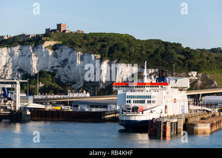 P&O Ferry in the Port of Dover, Dover Castle at the top of the White Cliffs of Dover, Kent, England, United Kingdom - Stock Image