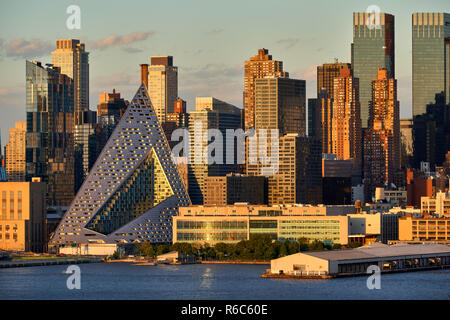 Aerial sunset view  of Midtown West Manhattan skyscrapers including the unique, modern pyramidal shaped Via West 57. New York City, USA - Stock Image