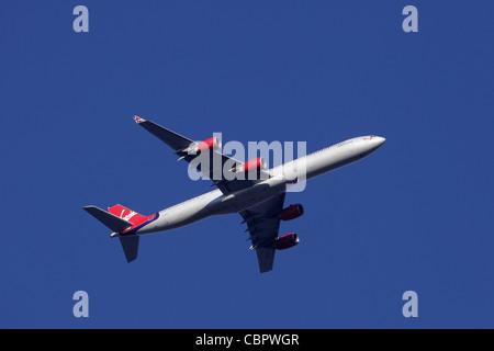Virgin Atlantic Airbus A340-600 G-VOGE ' Cover Girl ' in flight : clear sky - Stock Image