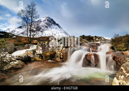 Highlands, Scotland, River Coupall going over falls near the entrance to Glen Etive with Stob Dearg mountain in - Stock Image
