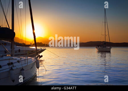 Ships and boats in Poros Island harbour in Greece - Stock Image