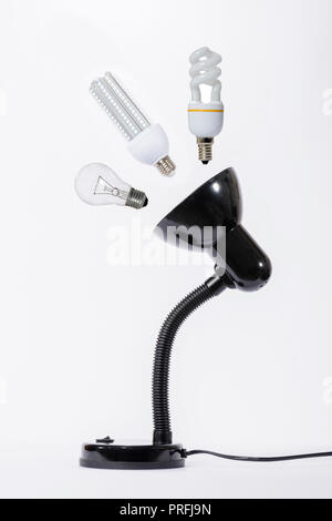 LED lamp replaces the old standard. White background - Stock Image