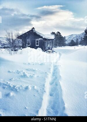 Mountain cabin in the snow - Stock Image