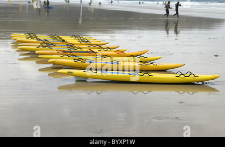 Kayaking and Surfing, Perranporth Beach, North Cornwall Coast, Britain, UK. - Stock Image