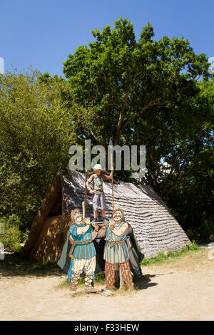 Young boy posing with gallic characters ((from the comic book asterix et obelix)) at Le Village Gaulois. - Stock Image