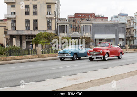 Cuba, Havana. Red and blue convertible cars driving side by side. Credit as: Wendy Kaveney / Jaynes Gallery / DanitaDelimont.com - Stock Image