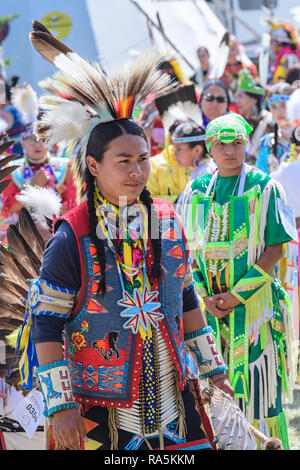 First Nation dancers at the Grand Entrance ceremony entering into the Beaver Dome. Tsuut'ina  Nation's Powwow. July 27-29, 2018 - Stock Image