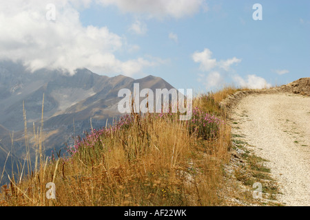 Strada Bianca or access road curving around Mont Sibilla in the  Sibillini National park Le Marche Italy - Stock Image
