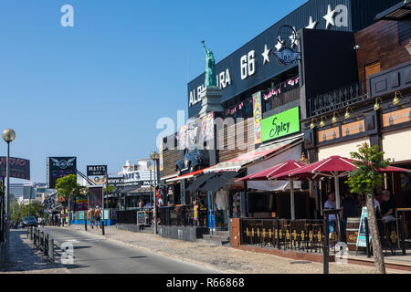 ALBUFEIRA, PORTUGAL - JULY 13TH 2018: A view of Avenida Sa Carneiro, known as The Strip, in Albufeira, Portugal on 13th July 2018.  The Strip is known - Stock Image