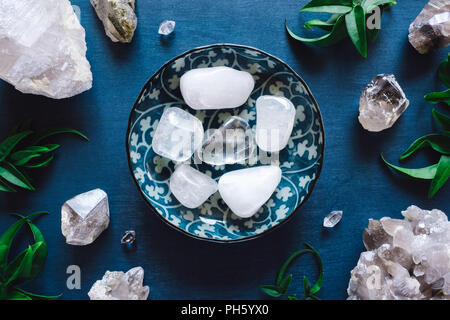 Clear and Smoky Quartz on Blue Table - Stock Image