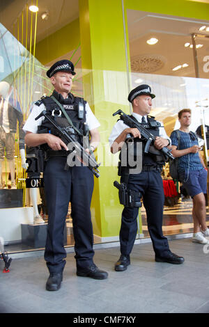 Armed Police on duty outside Westfield Shopping Centre, Stratford London E20 UK, - Stock Image