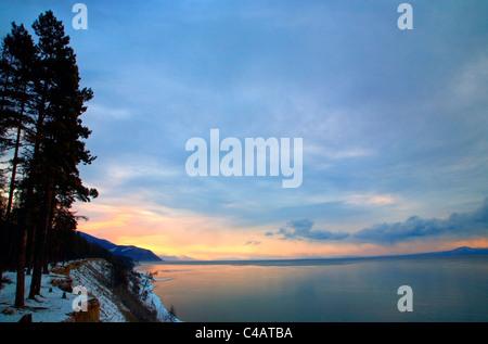 Russia, Siberia, Baikal; Morning light on Lake Bakal partly frozen in winter - Stock Image