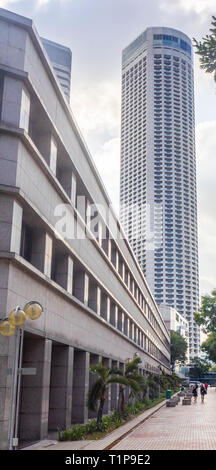 Facade of SMRT building along Stamford Rd, and Swissotel Stamford hotel tower Singapore. - Stock Image