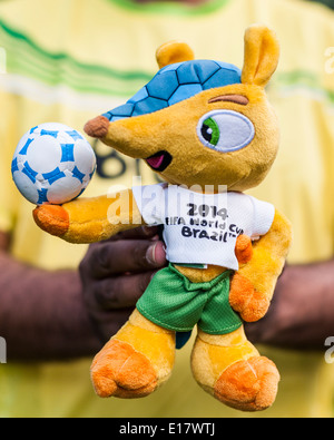 Man holding 'Fuleco the Armadillo' Mascot for Brazil World Cup 2014. - Stock Image