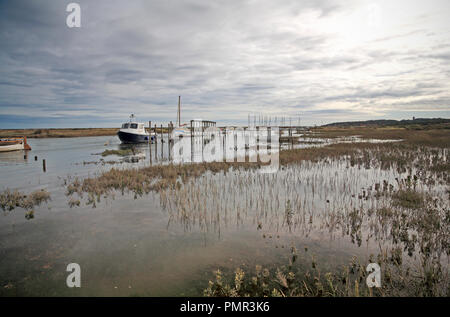 A view looking east along the Creek and flooded salt marshes on the North Norfolk coast at Morston, Norfolk, England, United Kingdom, Europe. - Stock Image