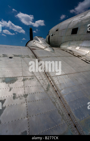 Derelict aircraft, C-47 Skytrain of ex JRV in Otocac, Croatia, dull shiny metal behind engine - Stock Image