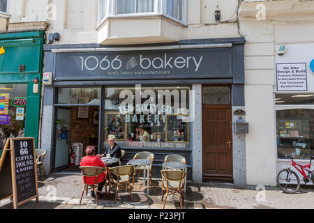 Couple eating in a terrace outside 1066 bakery, Hastings, East Sussex, England , UK - Stock Image