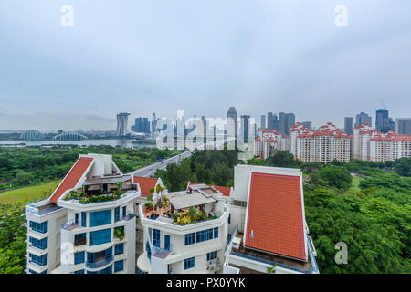 Sanctuary Green Condominium against the landscape backdrop of Central Business District in Singapore - Stock Image