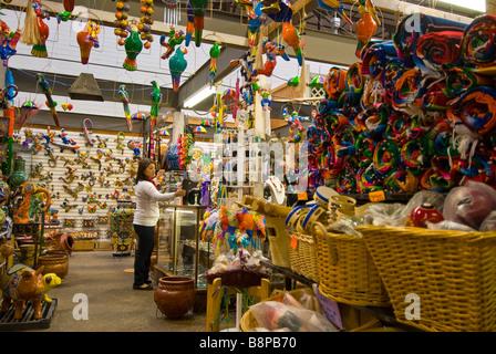 El Mercado woman clerk huge landmark Mexican shopping mall mexican souvenirs arts crafts Historic Market Square - Stock Image