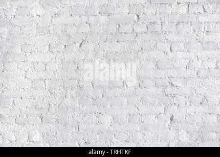 White rough brick wall close up. Texture and background - Stock Image