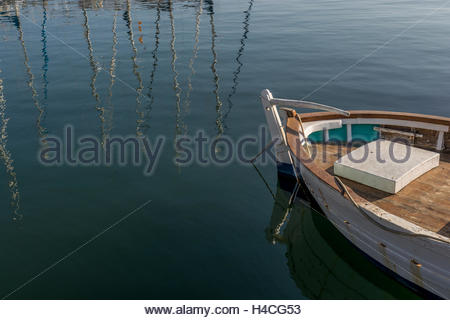 Old fishing boat moored at the port of Cambrils, Tarragona. Spain. These types of boats are usually used for fishing - Stock Image