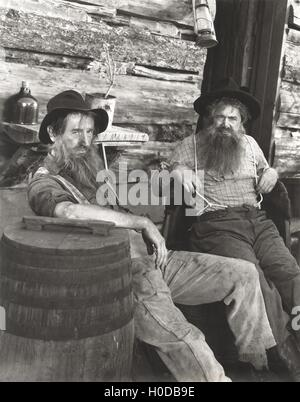 Two bearded men lounging - Stock Image