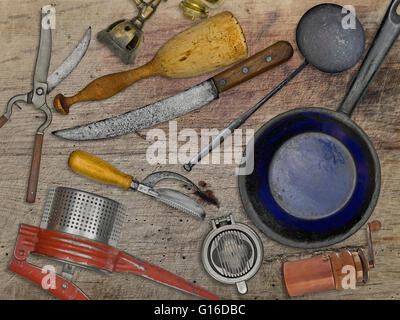 vintage utensils set for cooking over wooden table - Stock Image