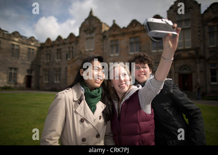 Students taking pictures of themselves - Stock Image