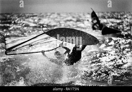 1994: Nik Baker, British Windsurfing Champion and the best windsurfer Britain has ever produced sails into trouble during a World Windsurfing Association event at  Brighton. - Stock Image
