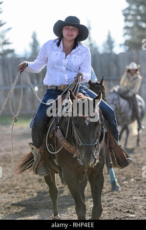 Native cowgirl in the warm-up arena at the Tsuut'ina Annual Rodeo & Pow Wow - Stock Image