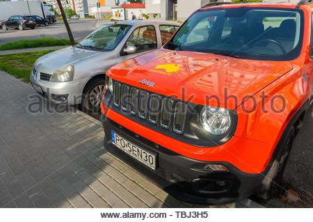 Poznan, Poland - May 24, 2019: New orange parked - Stock Image