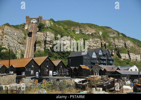 Hastings, UK -July 14 2018: The ast Hill Cliff Railway seen from the beach of the fishing port of Hastings on a hot summers day as the temperatures sore to above 27 degrees on 14 July 2018.  Hastings on the south coast of England is 53 miles south-east of London and is 8 miles from where the  Battle of Hastings took place in October 1066. Credit: David Mbiyu Credit: david mbiyu/Alamy Live News - Stock Image