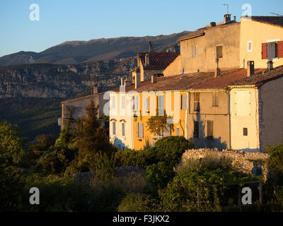 Sunset light on old houses in the village of Aiguines, Var, Provence, in Southern France. The mountains of the Verdon - Stock Image