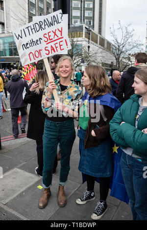 London, UK, 23rd March 2019. A million protestors march against Brexit and in support of a second referendum. A young marcher with her placard - Stock Image