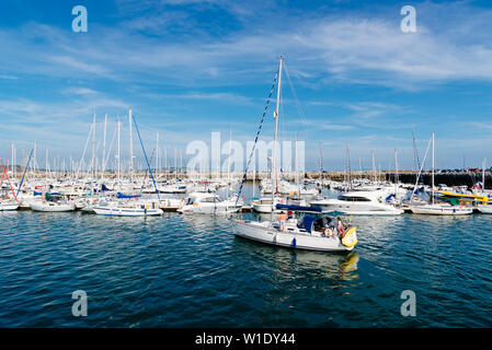 Morgat, France - August 4, 2018:  The marina of Morgat a sunny day of summer with many smalls boats aligned in the piers - Stock Image