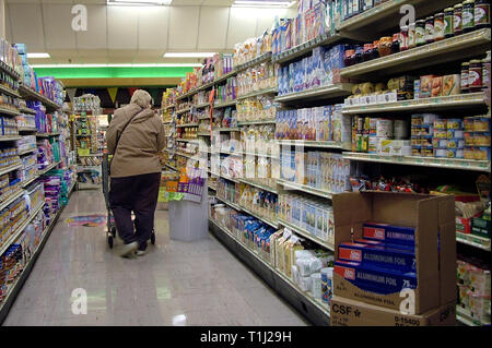 person shops inside the COOP store in greenbelt, Md t - Stock Image