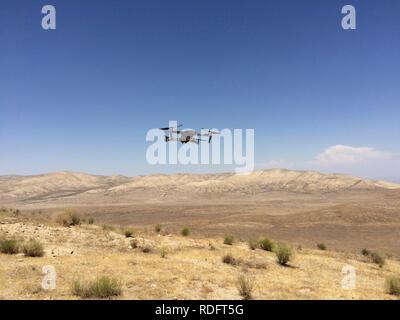 DJI Mavic Pro drone hovering over desert landscape ( camera drone ) - California USA - Stock Image