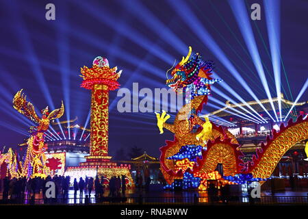 Xi'an, China's Shaanxi Province. 17th Feb, 2019. Visitors view lanterns at a scenic spot in Xi'an, capital of northwest China's Shaanxi Province, Feb. 17, 2019. Many places across the country are decorated with lanterns to celebrate the upcoming Lantern Festival, which falls on Feb. 19 this year. Credit: Jiao Hongtao/Xinhua/Alamy Live News - Stock Image