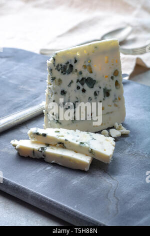 Piece of French blue cheese Roquefort, made from sheep milk in caves of Roquefort-sur-Soulzon - Stock Image