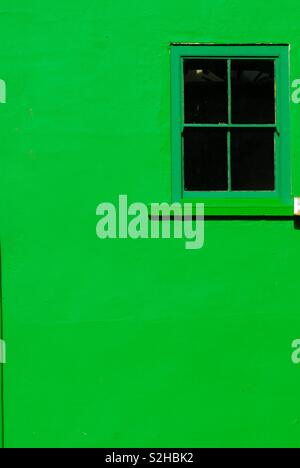 Green wall with window - Stock Image